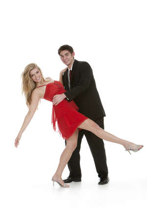 Attractive teenage couple dancing and posing on isolated white background 写真素材