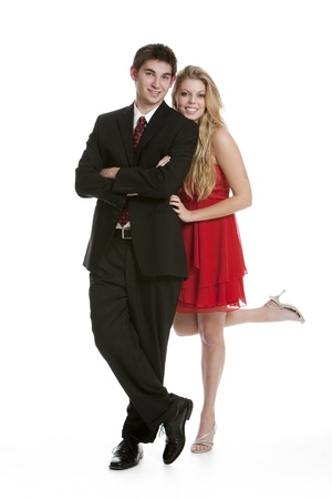 Teenage couple dressed in formal clothing standing close together