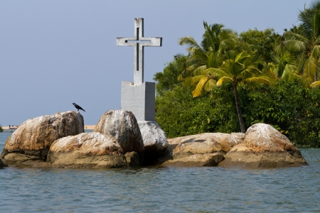 backwaters: The Christian cross on a small island in backwaters  Kerala, India