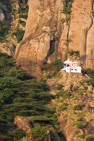 Small Hindu temple in the steep mountains near Kanyakumari  south India  photo
