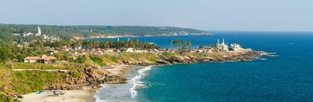 kovalam: View from the lighthouse at sunny beach, fishing harbour, mosques and church (Kovalam, Kerala, India )