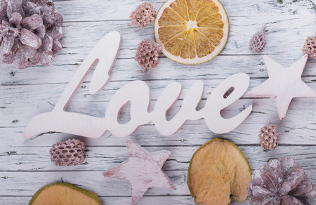 shrunken: Wood love sign and dried fruit Stock Photo