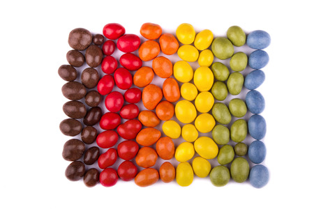 dragee: Dragee peanuts in colored icing lying in the shape of square on white background isolated.