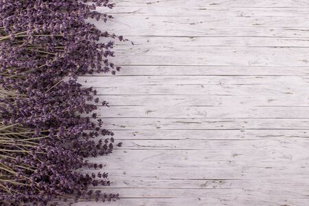 space wood: Bunch of dried lavender on wooden background.