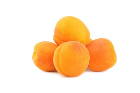 apricot kernels: Fresh apricots  isolated on a white background.