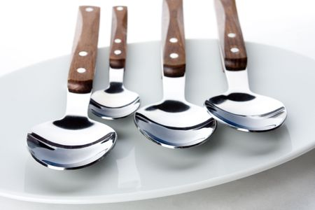 Different spoons on the white plate