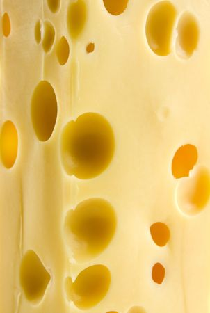 Piece of tasty cheese as background Stock Photo