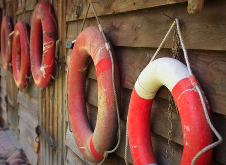 Lifebuoys on the wooden wall