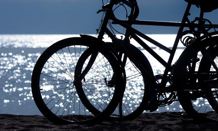 Silhouette of two bikes at the beach Stock Photo