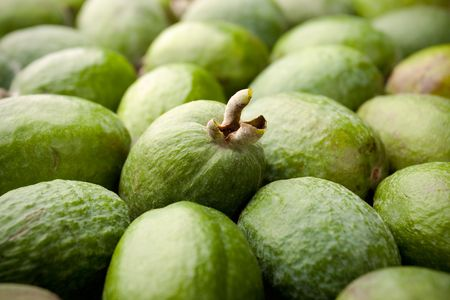 feijoa: Feijoa fruits with a focus on one Stock Photo