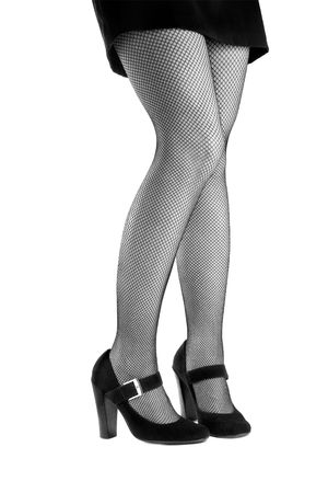 Woman�s legs in high heels and mesh stockings isolated on the white background shot in black and white photo