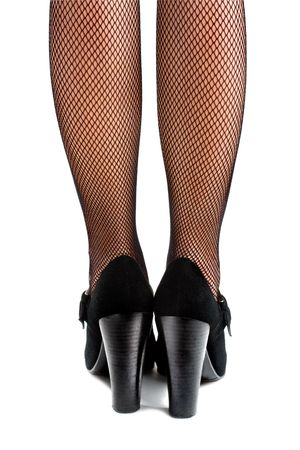 Closeup of woman�s legs in high heels and mesh stockings isolated on the white background photo