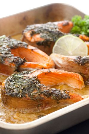 Closeup of trout baked with herbs in white wine