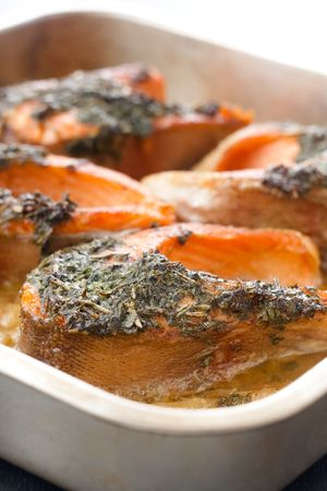 Closeup of trout baked with herbs in white wine photo