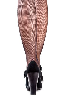 Closeup of woman's legs in high heels and mesh stockings isolated on the white background