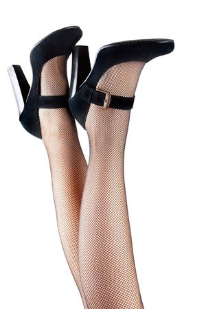 Closeup of womans legs in high heels and mesh stockings isolated on the white background