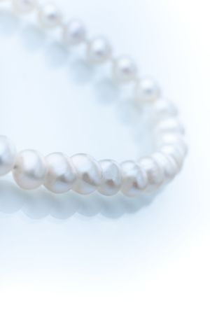 Closeup of  string of natural freshwater pearls, shallow focus Stock Photo