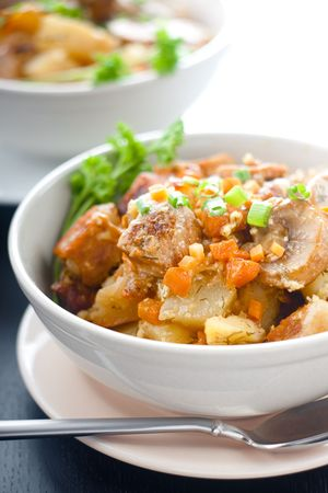 Pork stew with potatoes and mushrooms in a ceramic bowl Stock Photo - 5870054