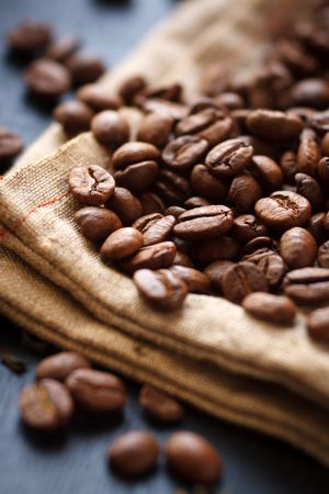Roasted coffee beans on canvas,shallow focus Stock Photo