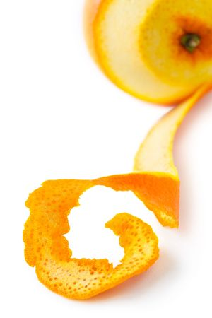 Orange with peeled skin on a white,shallow focus Stock Photo