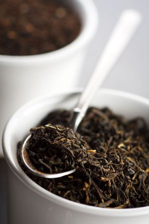 Black tea leaves in the cup,shallow focus Stock Photo