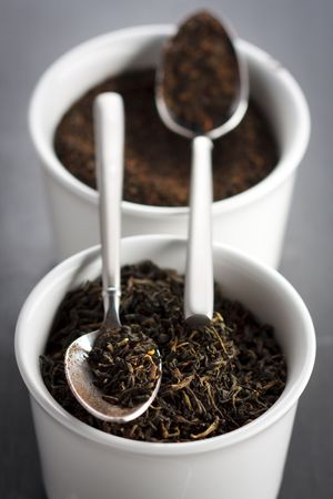Dry black tea leaves in the cup,shallow focus