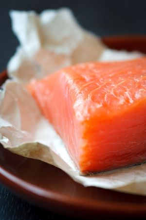 Fresh salmon fillet on the brown plate,shallow focus Stock Photo