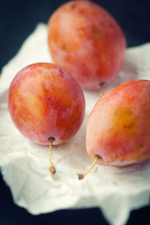 Fresh plums on paper,shallow focus Stock Photo