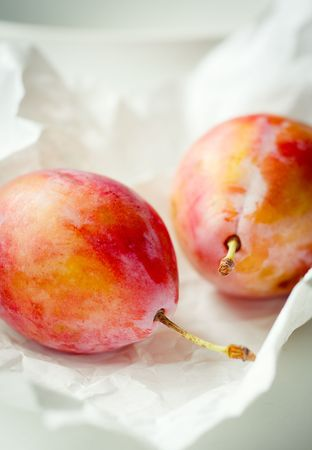 Fresh plums on the paper,cross process colors Stock Photo - 7805987