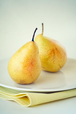 Natural pears on the white plate,shallow focus