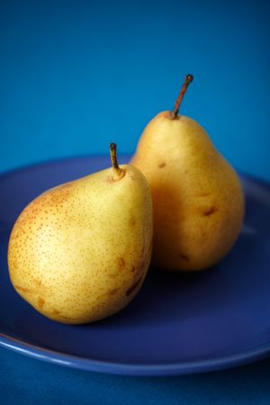 Natural pears on the blue plate,shallow focus