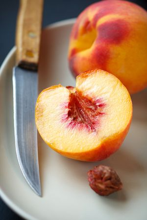 Ripe peaches on the white plate,shallow focus Stock Photo