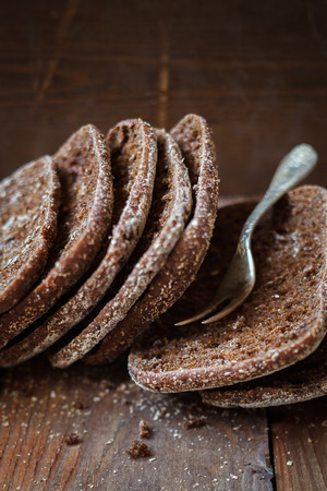 finnish: Finnish rye flat bread,rustic background,selective focus Stock Photo