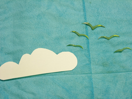cuttings: Flat Lay Composition of Birds flying trough the Clouds