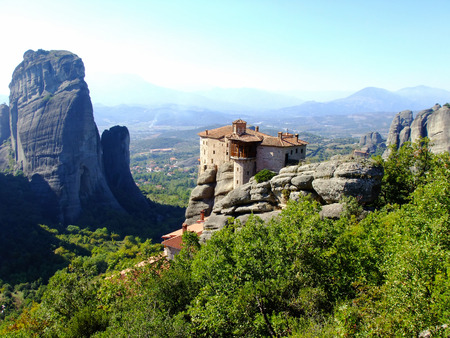 Monastery of Meteora on the Cliffs high above the Ground in Greece Stock Photo