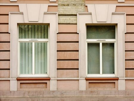 louver: Two different Windows of old red Building