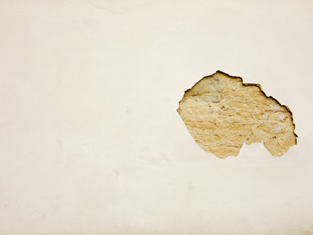 Background with a Plaster crumbled off of an old alcient Masonry Wall