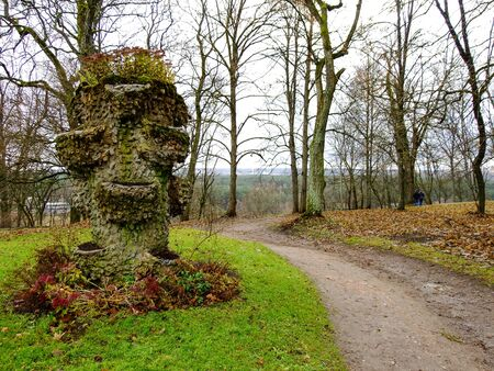 intresting: Wooden Sculpture with Flowers in the Park of Lithuania Stock Photo