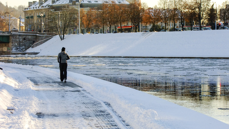 runing: Man runing on the Riverside of Neris River in Vilnius City, Lithuania