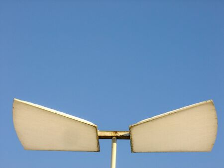aluminium background: Lighting Fixture on aluminium Pole in Background of blue Sky