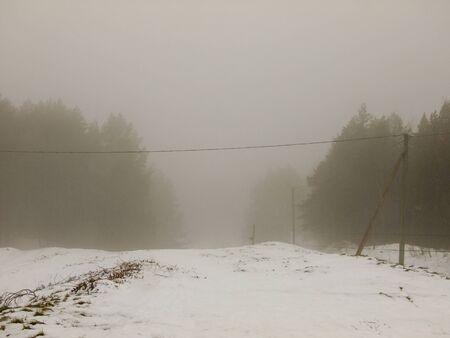 nowhere: Road on the Hill in Vilnius City, Lithuania leading through the Mist to nowhere