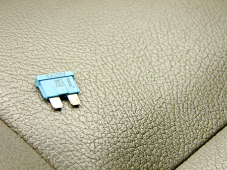 car fuse: Small blue Fuse on the Background of Front Leather Seat of A luxury Car Stock Photo
