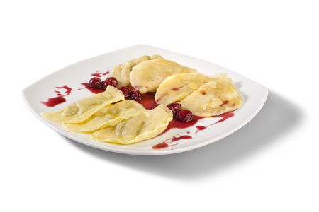 Ukrainian national dish varenyky (ravioli) with cherry closeup. Stock Photo