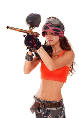 Sexy young girl posing like playing paintball photo