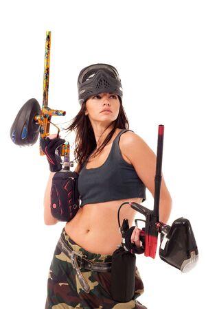 Sexy young girl posing like playing paintball