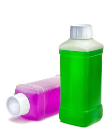 Two transparent plastic bottles with color cleaning liquid. One standing and one lying. Stock Photo