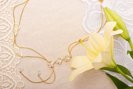 Chain and lily on lace background Stock Photo - 6649586
