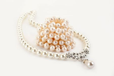 Pendant on pearl chain. Isolated on light background