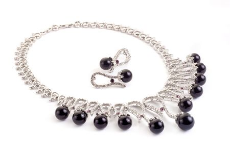 Necklace with black pearls on a white background photo