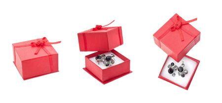 Earring in red present box isolated on white